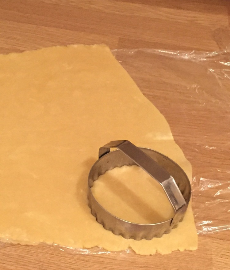 cutting out mince pies